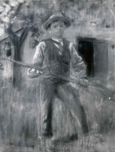 Dječak grablja sijeno